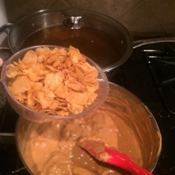Butterscotch Drops Recipe - Melt butterscotch chips with peanut butter, stir in cornflakes, and you've got a quick and easy treat!