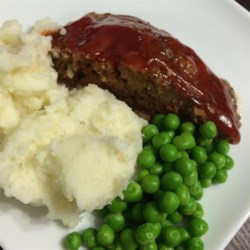 Mom's Meatloaf Recipe - Glazed with a sweet ketchup sauce, this meatloaf is sure to become a family favorite!