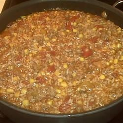 Mexican Rice Recipe - Ground beef, rice, onion, green pepper and fresh corn are simmered in a spicy tomato and beef broth mixture in this easy one-pot meal. Serve with flour tortillas, sour cream, and salsa.