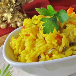 Cindy's Yellow Rice Recipe - This quick and easy recipe for yellow rice has fantastic and flavorful results, thanks to turmeric, garlic, and onion.
