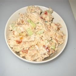Chicken Salad II Recipe - This delicious chicken salad is bursting with different flavors and textures: tender chicken teams up with crunchy celery, nutty pecans, pungent cilantro, tangy pineapple, spicy green onion and sweet red apples for an unforgettable treat.