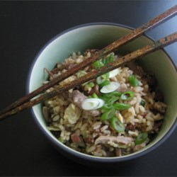 Duck Fried Rice Recipe - This is how I like to use up leftovers from our favorite take-out meal of Chinese roast duck and barbequed pork. Ingredient amounts may vary depending on what's left from your meal. But fried rice dishes are very forgiving.