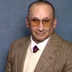 Dr. Charles L. Vaughn,B.A., B.S.W., B.A., M.P.A., D.D.