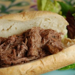 Slow Cooker Italian Beef for Sandwiches Recipe and Video - Rump roast is cooked with Italian salad dressing mix and seasonings until it is tender enough to shred with a fork.