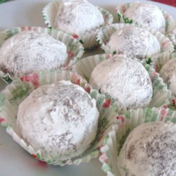 Meemaw's Bourbon Balls Recipe - A little bit of bourbon goes into these balls of crushed vanilla wafers and pecans. Roll them in confectioners' sugar and coconut for added layers of flavor.