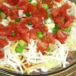 Quick and Easy Dip Recipe - This 4-layer Mexican-style dip can be made in just a few minutes and is usually eaten just as quickly. Serve with corn tortilla chips.