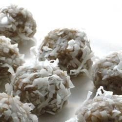 Coconut Rum Balls Recipe - The flavor of these candies improves after 24 hours. They may be made ahead and stored in refrigerator. Roll in confectioners' sugar instead of coconut if you prefer.
