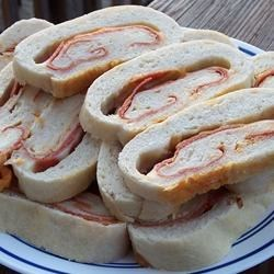 Jet Swirl Pizza Appetizers Recipe - Similar to meat-filled calzones, these cheesy little swirls were invented during football season. The name was inspired by our favorite team.