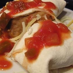 Best Burritos Recipe -  Anything with refried beans is great in our book, and this very simple recipe showcases them well. A warm tortilla is filled with beans, cheese, pepper, sour cream and hot sauce. Then it 's rolled, put on a plate and enjoyed.