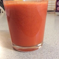 Vegetable and Fruit Juice Recipe - The juice of fresh carrots, strawberries, tomato, and apple with a hint of ginger makes a delightfully tasty treat or pick-me-up.