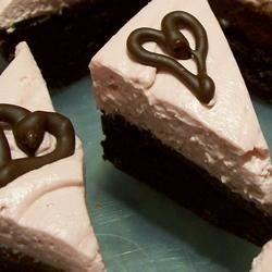 Raspberry Fudge Brownies Recipe - These moist chocolate brownies are topped with a rich fudge layer and a fluffy raspberry cream cheese frosting. To make them even prettier, I like to garnish them with chocolate curls.