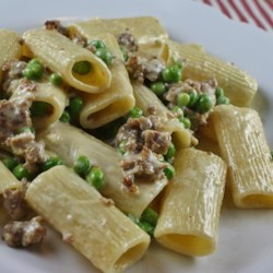 Pasta with Peas and Sausage Recipe - Rigatoni pasta in a creamy sausage sauce with green peas.
