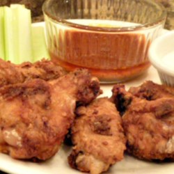 Jeri's Spicy Buffalo Wings Recipe - The sauce in this recipe is made with butter and hot sauce while the wings have their own flavor from marinating in apple cider vinegar seasoned with onion salt, garlic salt, paprika, and red pepper flakes.