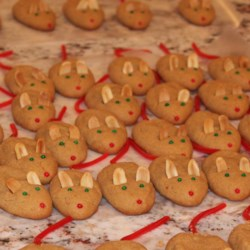 Peanut Butter Christmas Mice Recipe - These adorable little cookies are made of creamy peanut butter, butter, sugar, egg and flour.  They are transformed into little mice with peanut halves for ears, green candies for eyes, and red licorice for tails.
