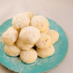 Grandma Minecci's Snowball Cookies Recipe - Grandma's snowball cookie recipe has been passed down through the generations and is a family-favorite during the holiday season.