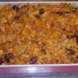 Throw Together Mexican Casserole Recipe - Ground beef, olives, egg noodles, corn, taco sauce and seasoning give this throw together casserole it's South-of-the-border flavor.