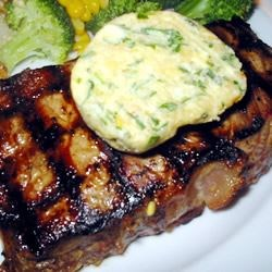 Tenderloin with Spicy Gorgonzola-Pine Nut-Herb Butter Recipe - Filet mignon steaks are grilled outdoors and dabbed with a spicy, Gorgonzola, pine nut, and herb butter.  You can make the butter in advance and just leave it at room temperature to soften as needed.