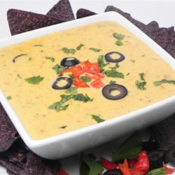 Loaded Queso Fundido Recipe - This cheesy Mexican-style fondue is loaded with chicken, chorizo, mushrooms, and jalapeno pepper. Try it for your Cinco de Mayo celebration.