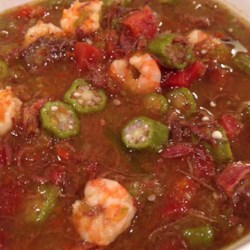 Teddy's Duck Gumbo Recipe - Gumbo with a twist! Duck is added to the traditional spicy medley of shrimp, smoked sausage, bell peppers, onions, garlic, celery, and tomatoes to create a rich, hearty dish. Serve hot over white rice, and substitute other poultry for the duck if you wish.