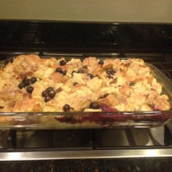 Beth's Blueberry Bread Pudding  Recipe - Blueberry bread pudding baked with a homemade golden sauce is a rich and tasty dessert for special occasions.