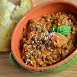 Hearty Italian Lentil Soup Recipe - My mom used to make this during cold winter nights to warm us up. Now I make it all the time because it not only warms you up, it soothes the soul. This recipe is perfect for using up leftover rice and pasta sauce. You can change the recipe to suit your tastes; use your favorite jarred sauce if you don't have any homemade, or use your own family's meatball recipe!