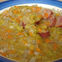 Slow Cooker Split Pea Sausage Soup Recipe - Dried split peas and smoked sausages are combined in this slow cooker soup with carrots, potatoes, oregano and garlic powder.  Allow 5 hours cooking time.