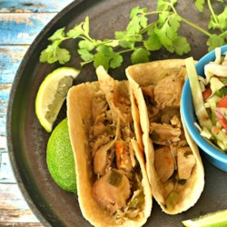 Spicy Turkey Tacos Recipe - Transform your leftover turkey into spicy turkey tacos using taco seasoning and jalapeno peppers in a slow cooker; serve in small tortillas.