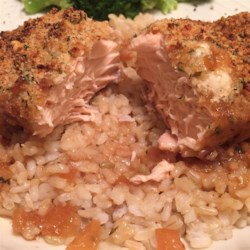 Parmesan Crusted Salmon Recipe - A lightly seasoned Parmesan cheese crust brings a bold but not overpowering flavor to salmon steaks cooked in a white wine and teriyaki marinade.