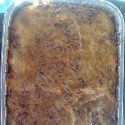 Green Chile Chicken Enchilada Casserole Recipe - Green chile and chicken enchilada casserole has plenty of kick from green chiles and green chile salsa layered between tortillas and cheese.