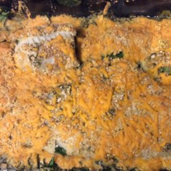 Crunchy Cheesy Fish and Spinach Casserole Recipe - White fish is layered between spinach and a crunchy Cheddar cheese topping for a quick weeknight dinner everyone will love.