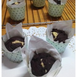 Chocolate Filled Muffins Recipe - There 's a little ball of almond-perfumed coconut tucked inside each of these muffins that are subtley flavored with chocolate and cinnamon.