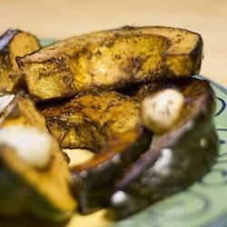 Roasted Acorn Squash Recipe -  Acorn squash are so beautiful as is, but even more so when sliced in half and baked. For this flavorful dish, the cooked squash meat is mixed with onions, coriander, nutmeg and garlic, and heated on the stove until hot and delicious.