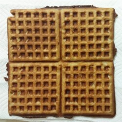 Beer Batter Waffles Recipe - Beer makes these honey-sweetened waffles light and crunchy.