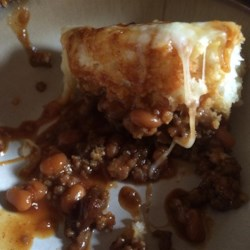 Burien Bisquit and Baked Bean Bowl Recipe - Ground pork and beans are baked under a biscuit topping loaded with Cheddar and mozzarella cheese creating a family-approved comfort food.
