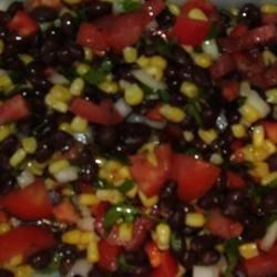 Mexican Salad Recipe - The dressing of olive oil, lime juice and honey is a nice addition to this traditional bean/corn/pepper/tomato salad. And the jalapeno peppers add a nice bite. A perfect filling for a fluffy brunch omelet, or to spoon onto a serving of scrambled eggs.