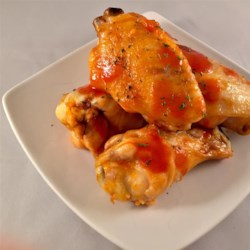 The Best Chicken Wings Recipe - The best chicken wing recipe includes a spicy and tangy sauce that will receive rave reviews every time.