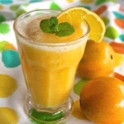 Orange Summer Cooler Recipe - This is a great Fourth of July people pleaser. Or anytime, especially if you live under the hot Southern summer sun. Feel free to experiment with different flavors of sherbet!