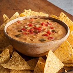 World's Best Queso Dip Recipe - You will love our super simple, delicious, 2-ingredient recipe! Why World's Best? Because of our fresh tasting Red Gold Petite Diced Tomatoes & Green Chilies. Add ground beef, chorizo, beans or whatever you please to create your flavor favorites!