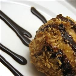 Fried Ice Cream Recipe - Vanilla ice cream is coated with egg white and corn flakes spiced with cinnamon, then quickly fried for a paradoxical paradise.