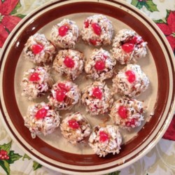 Cherry Winks Recipe - Cookies are rolled in crushed corn flakes and topped with a quarter of a maraschino cherry.