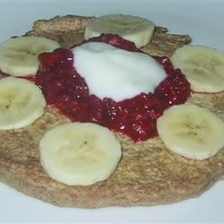Whole Wheat and Quinoa Pancakes Recipe - These flavorful pancakes are served with a simple maple syrup and mixed berry topping and a dollop of vanilla yogurt.