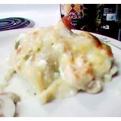 Sarah's Chicken Lasagna Recipe - Chicken, cottage cheese, Parmesan and a creamy, cheesy sauce layer with noodles--no tomatoes in this nontraditional lasagna.