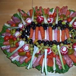 Antipasto Platter Recipe - A variety of cheeses and deli meat slices are layered with vegetables, peppers and spices to create a mighty party platter that's filled with exciting flavors and easy on the eyes.