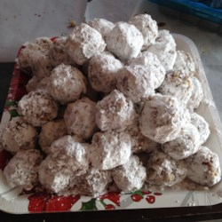 Date Balls Recipe - These date balls get texture from the addition of pecans and crisped rice cereal. They're an ideal addition to your Christmas cookie platter!