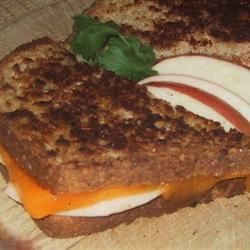 Grilled Cheese, Cinnamon, and Apple Sandwich Recipe - Apple slices sprinkled with cinnamon adds a unique component to a grilled cheese sandwich in this recipe.