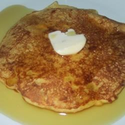 Cheddar Corn Pancakes Recipe - This batter tastes so good, you 'll be tempted to lick it from the spoon. Cornmeal, eggs, milk, baking powder and sugar are stirred and waiting. In goes the corn and cheddar cheese, and the rest is up to the griddle. Maple syrup poured on top is divine.