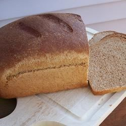 Kid-Friendly Wheat Bread Recipe - An easy kid-friendly wheat sandwich bread, especially easy if you have a mixer with a dough hook.  My picky kid even eats the crust!