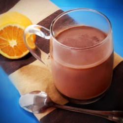 Christmas Orange Hot Chocolate Recipe - Orange hot chocolate with a hint of cinnamon is the perfect beverage to make on Christmas day and drink in front of a warm fire.