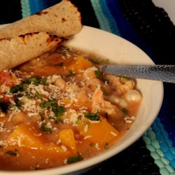 Chicken Butternut Squash Posole Recipe - Chicken and butternut squash posole with hominy and salsa is cooked in the slow cooker, creating a hearty meal for weeknight dinner.