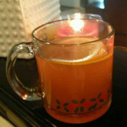 Colonial Holiday Cup Recipe - The perfect beverage for a cold day! Apple, orange, and lemon juices are spiced with a blend of cinnamon, cloves, and allspice.